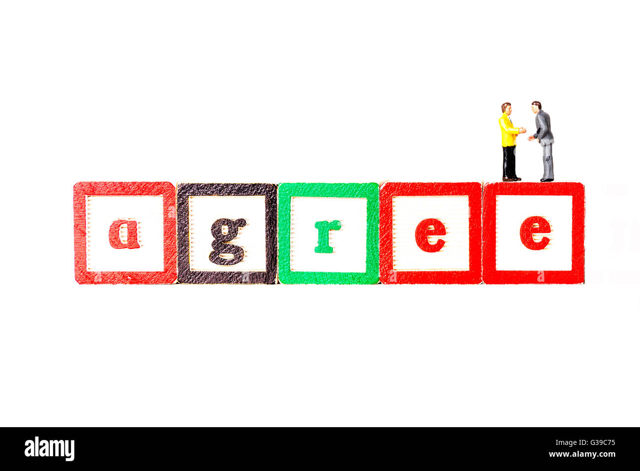 Agree agreement deal business businessmen men agreeing shaking hands handshake Cutout cut out white background isolated Stock Photo
