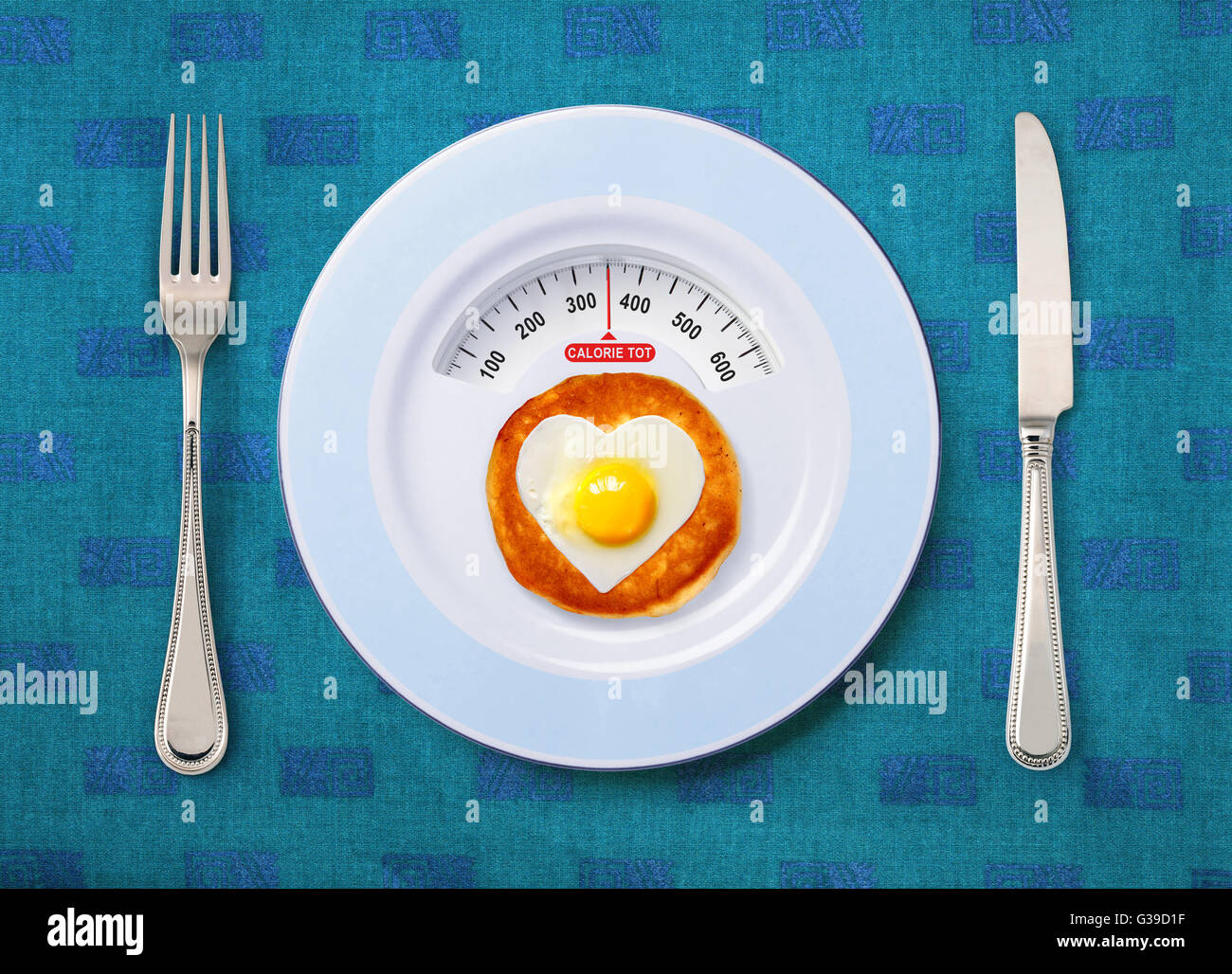 view of calorie tot in fried egg that on white plate - Stock Image