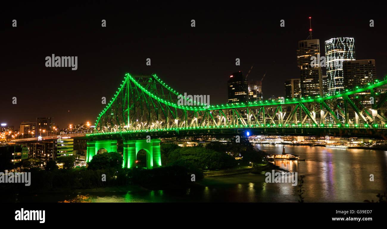 Story Bridge Brisbane Australia. Lighten up in green lighting with water reflection - Stock Image