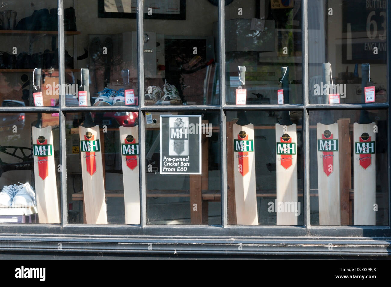 Secondhand cricket bats for sale in a Taunton shop window. - Stock Image