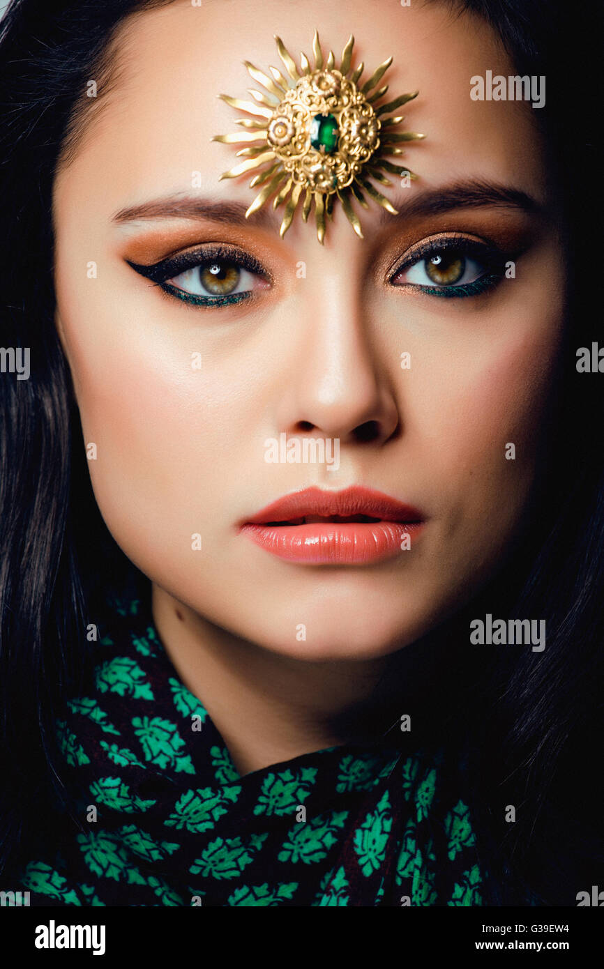 beauty eastern real muslim woman with jewelry close up, bride  star creative makeup - Stock Image