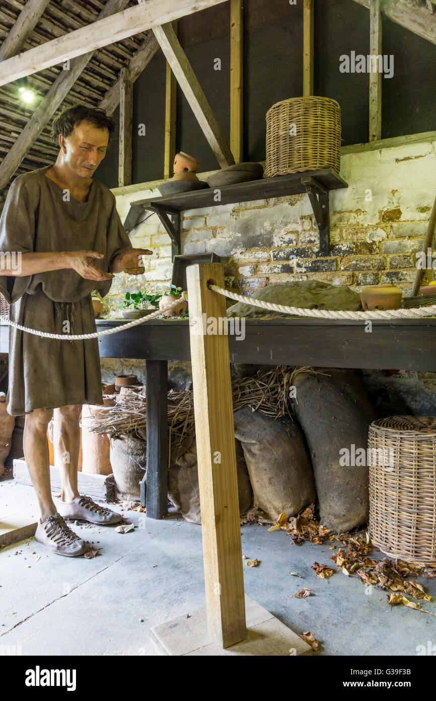 Part of a display at the Roman Garden Museum at Fishbourne Roman villa shows a reconstruction of a slave's working - Stock Image