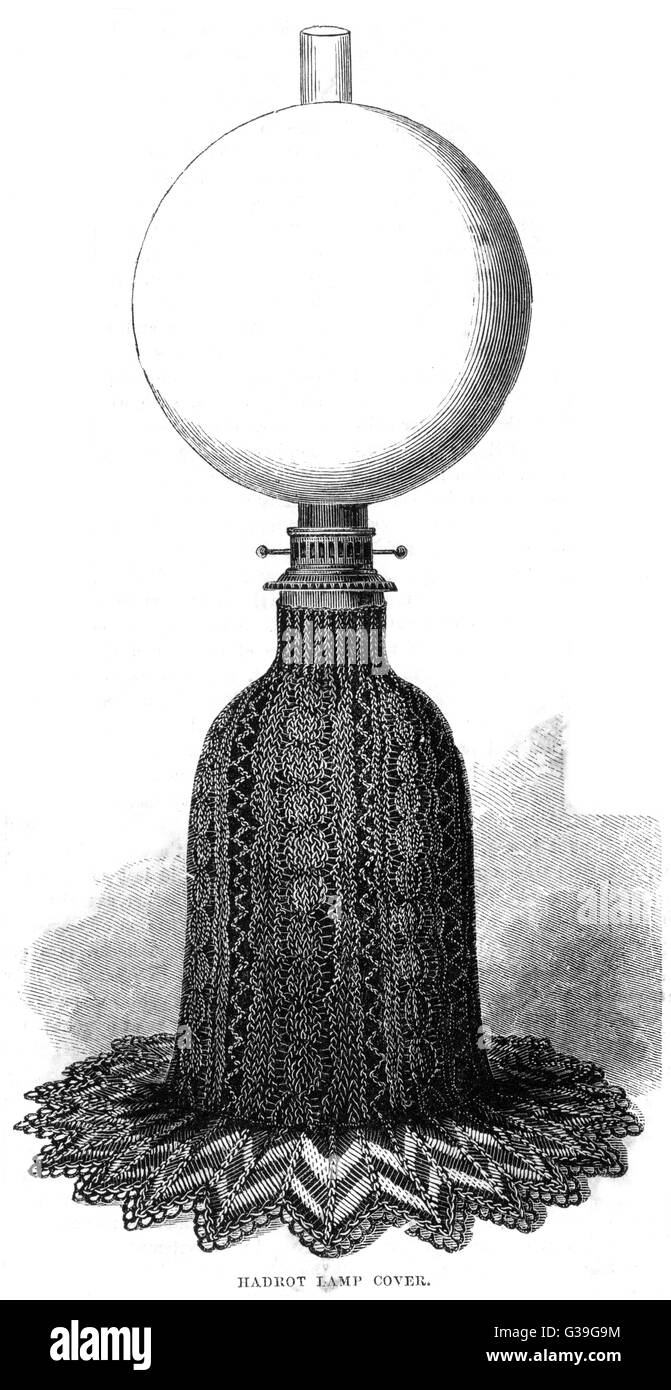 A Hadrot oil lamp with  covering on base         Date: 1860 - Stock Image