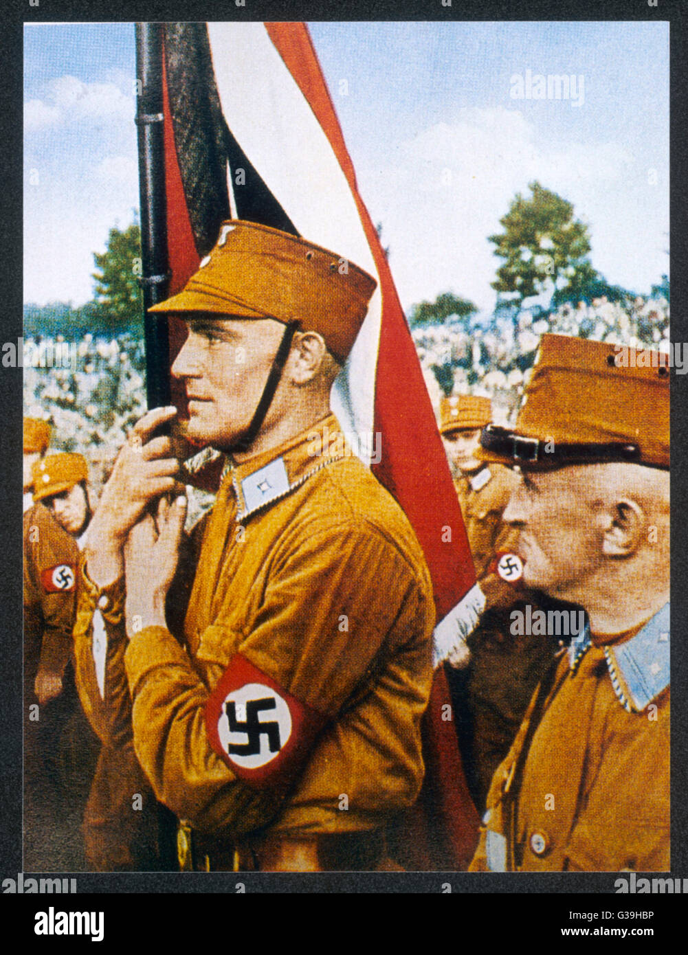 SA man and Nazi flag as  depicted by the Nazi media.        Date: 1930s Stock Photo