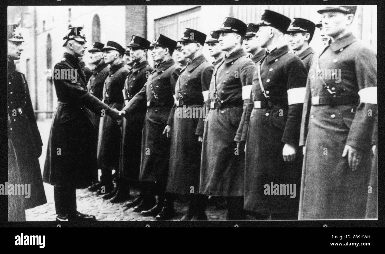 "SA and SS men are taken on as  ""auxiliary police"" by a  ""handshake"".        - Stock Image"