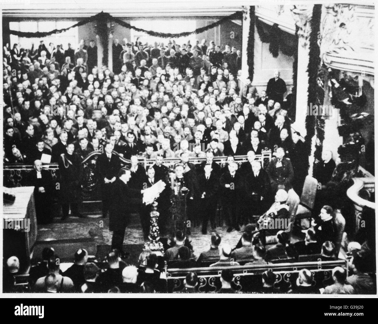 Members of the Reichstag assembled in the Potsdam  Garnisonkirche on Potsdam Day and wait for Hitler to arrive to - Stock Image