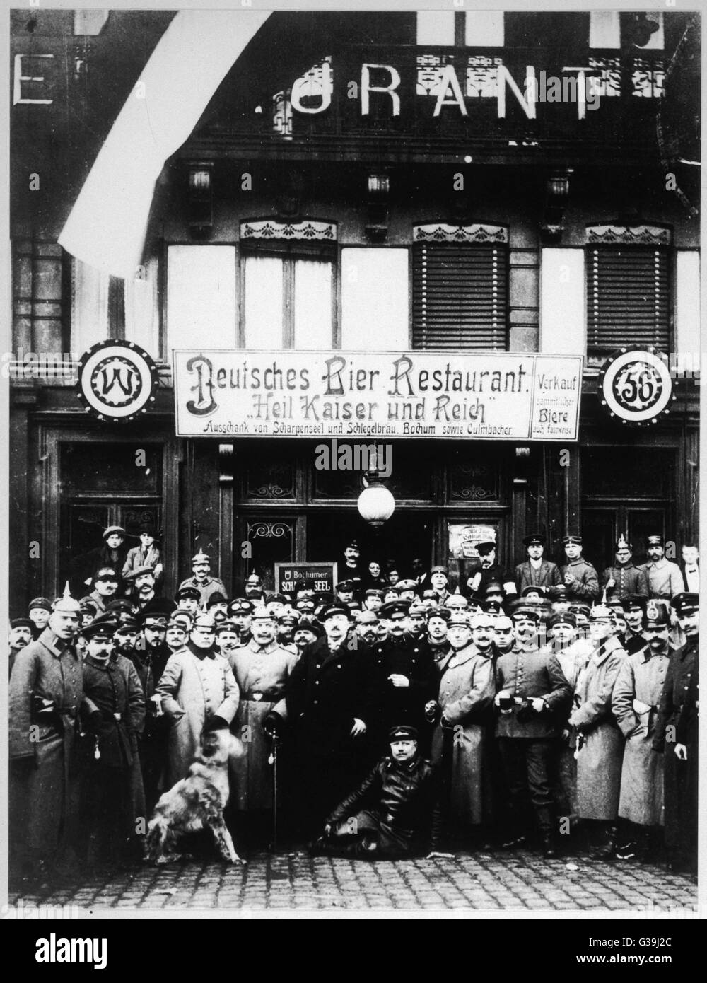 German soldiers and airmen  pose for a photograph outside  a Lille (?) cafe. The sign reads  'German Beer Restaurant. - Stock Image