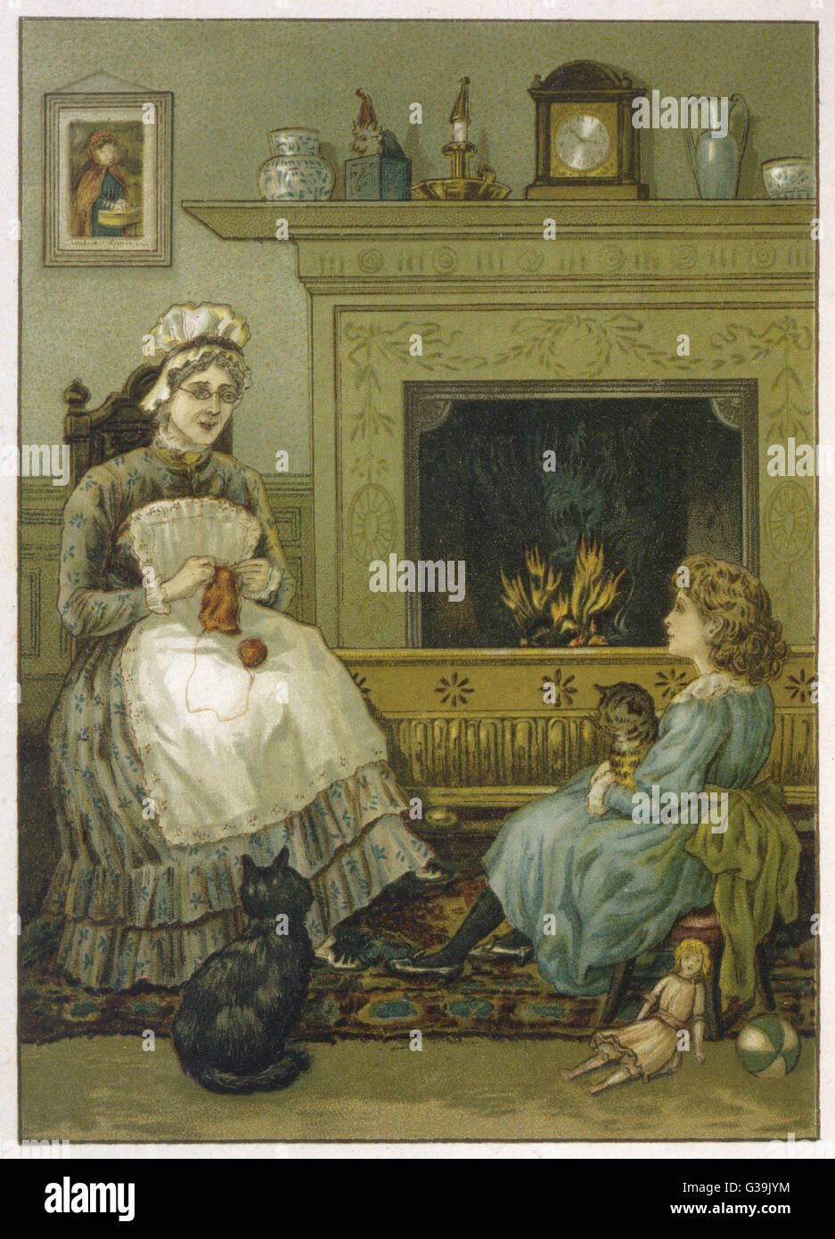 A child with a cat in her arms  has laid aside her doll to  listen to her nurse who sits  sewing by the fire, watched - Stock Image