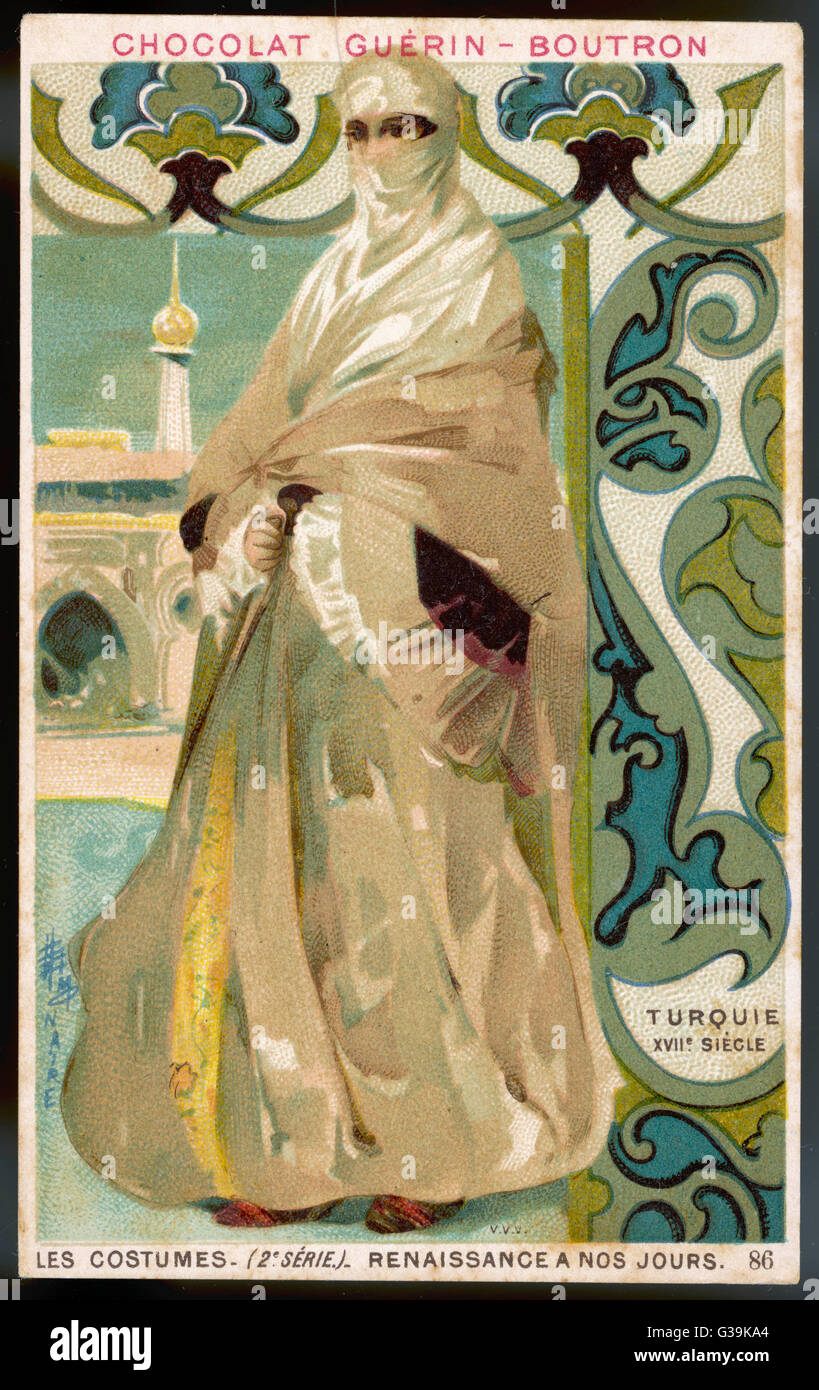 A Turkish lady, well concealed  in her voluminous white and  cream costume with only her  eyes visible; there is - Stock Image