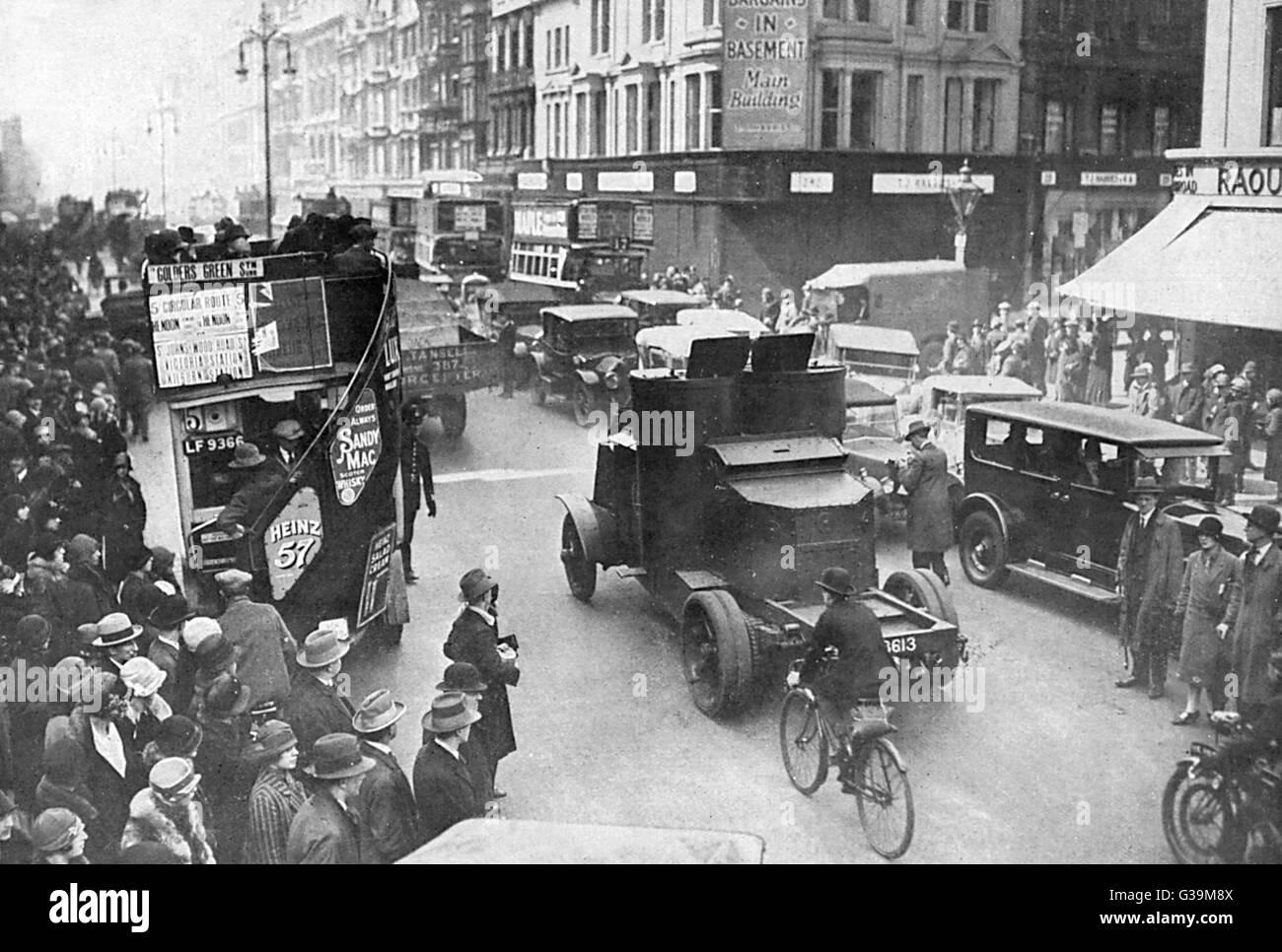 Armoured cars on London's  streets provide protection for  food convoys and evoke cheers  from the watching - Stock Image