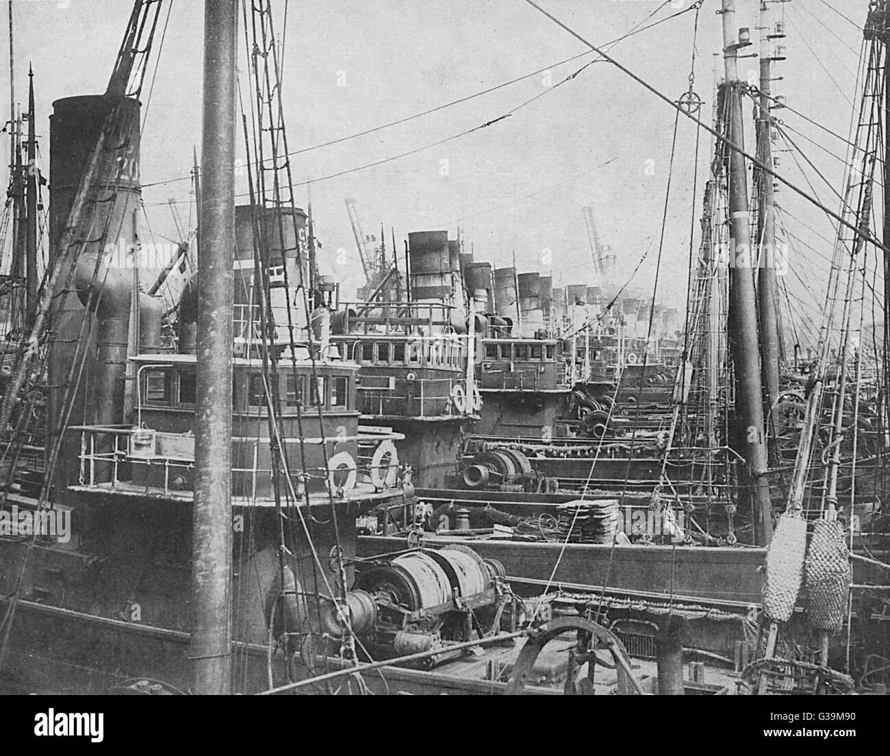 Fishing trawlers and liners   laid up at the Fleetwood docks,   owing to shortage of coal due  to the General Strike - Stock Image