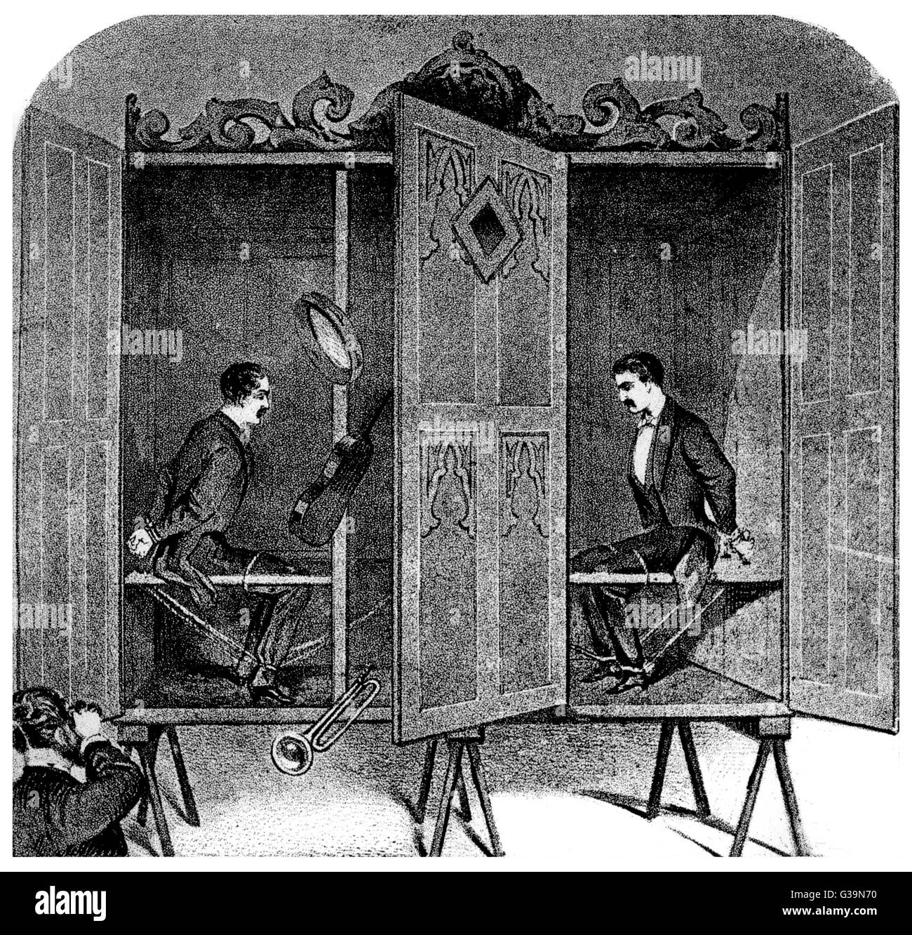 The brothers are securely  tied, then locked in their  cabinet - and yet objects are  moved, instruments play and - Stock Image
