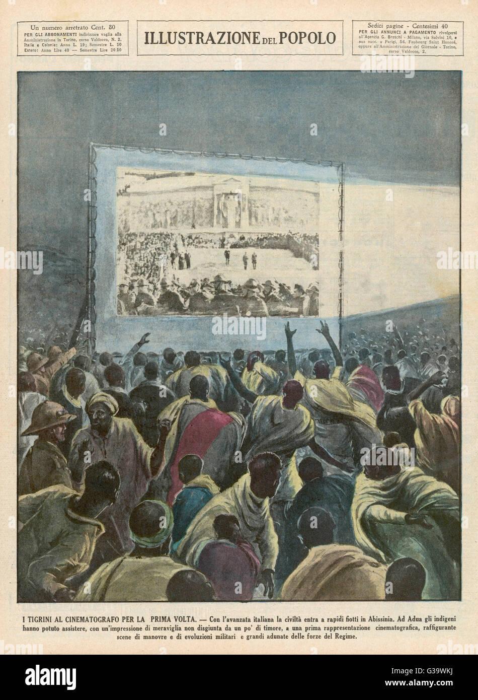 Natives of Italian-occupied  areas watch Italian   propaganda films        Date: 1935 - Stock Image