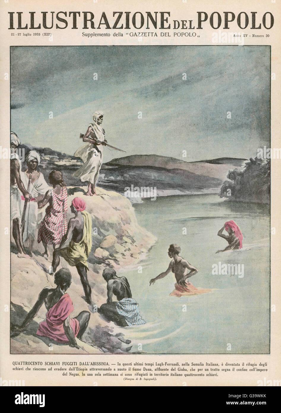 400 hundred slaves cross the  Dawa river from Ethiopia, seeking  refuge in Italian Somaliland        Date: 1935 - Stock Image