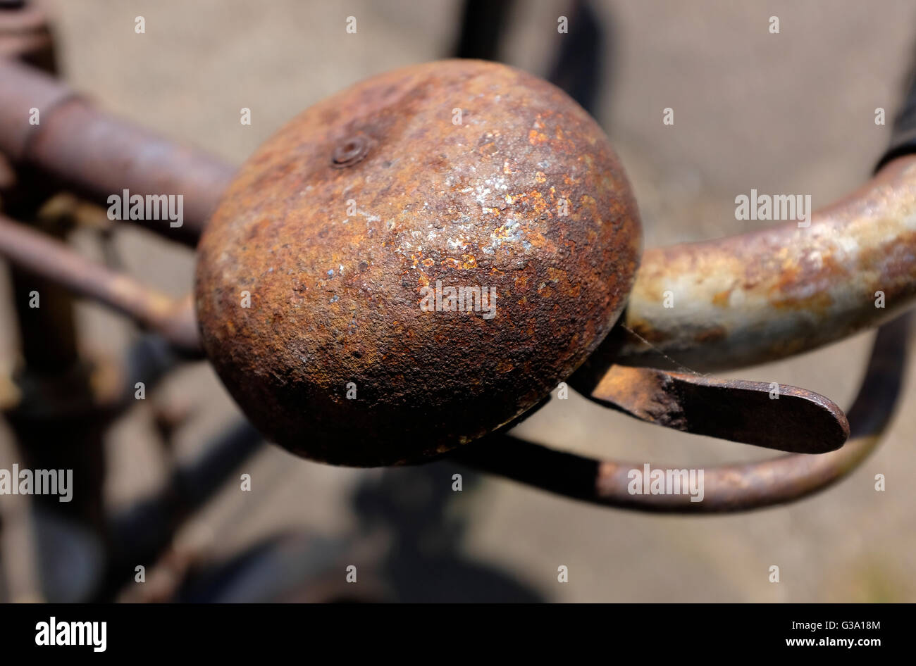 old rusty metal bicycle bell on handlebars - Stock Image