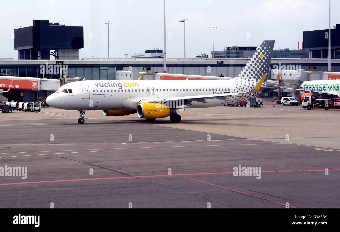 Airbus A 320 of Vueling.com airlines Schiphol international airport Amsterdam Netherlands - Stock Image