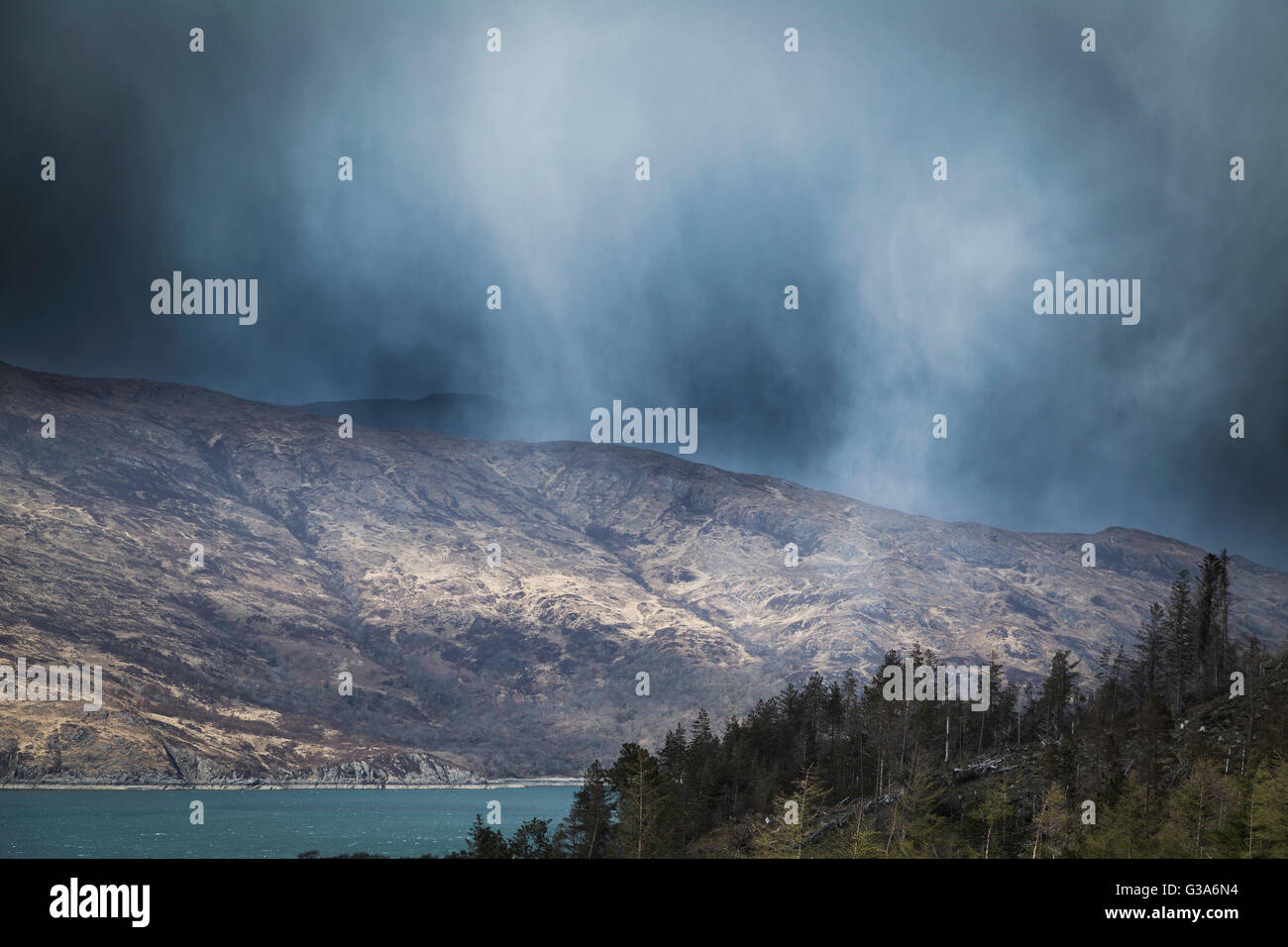 Snow squall through the Sound of Sleat, Loch Hourn, Western Highlands, Scotland - Stock Image
