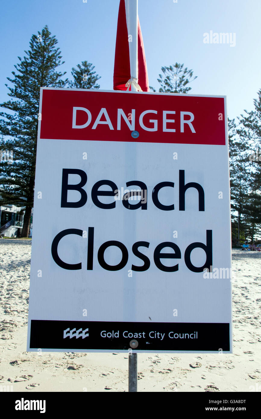 Sign warning that the beach is closed for swimming and surfing after a storm on the Gold Coast in Australia - Stock Image
