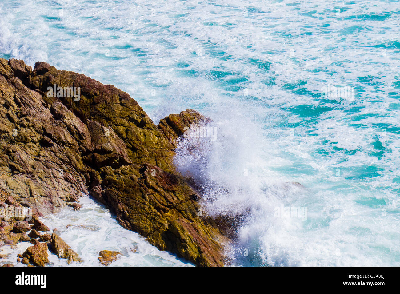 Waves crashing on to rock on the Gold Coast in Australia - Stock Image