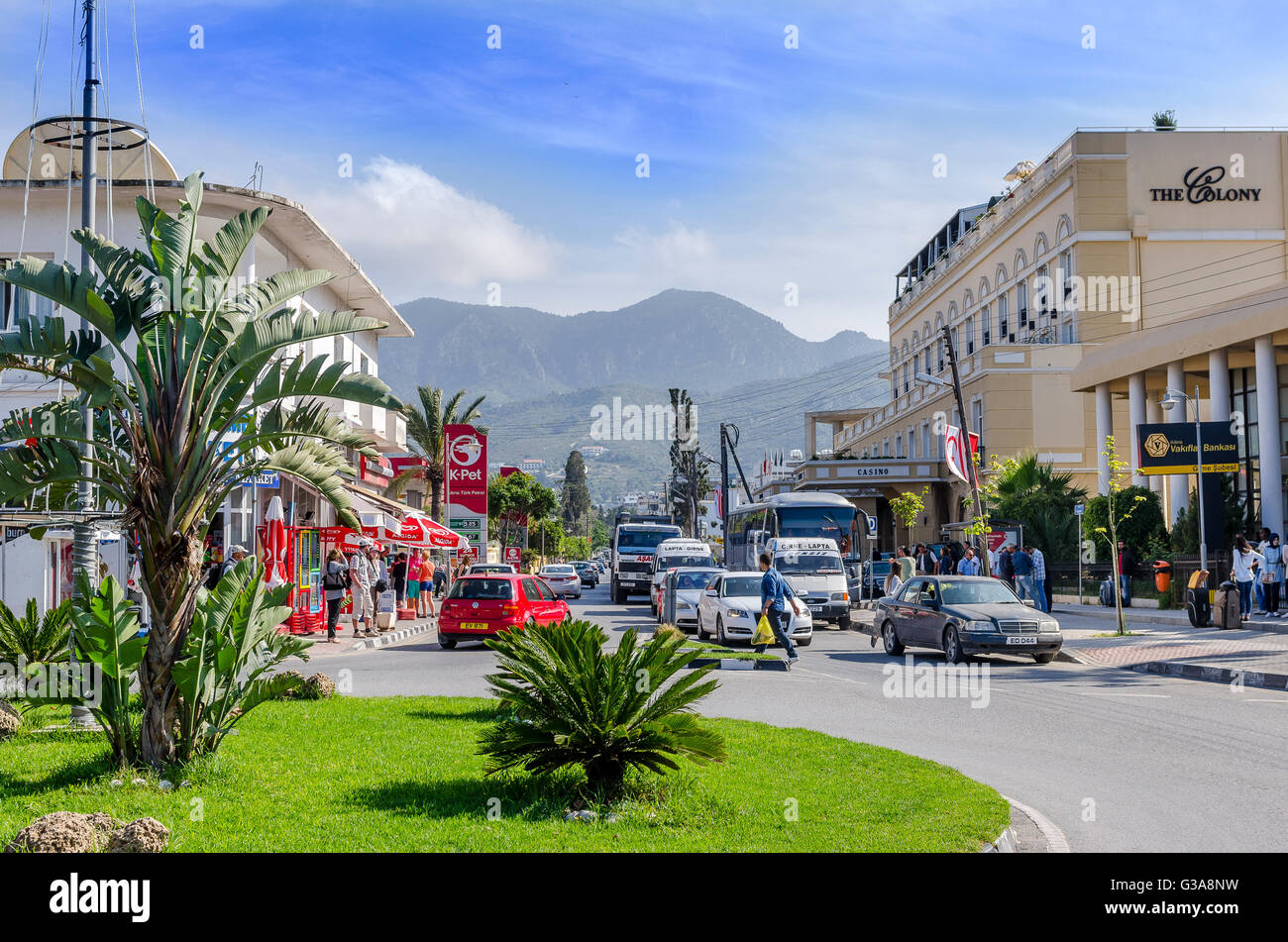 Traffic driving along a street in the city of Kyrenia, Northern Cyprus. - Stock Image