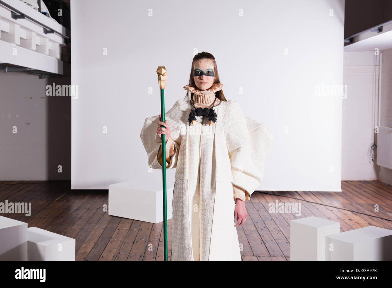 Extravagant fashion show model looking into camera - Stock Image