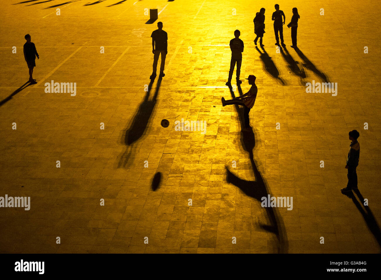 Young people play soccer at night on the Quang Truong square in Sapa, Lao Cai province, Vietnam - Stock Image
