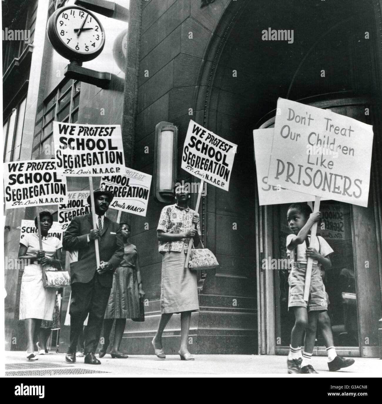 Demonstrators picket in front of a school board office protesting segregation of students. Part of a Picture Story Stock Photo