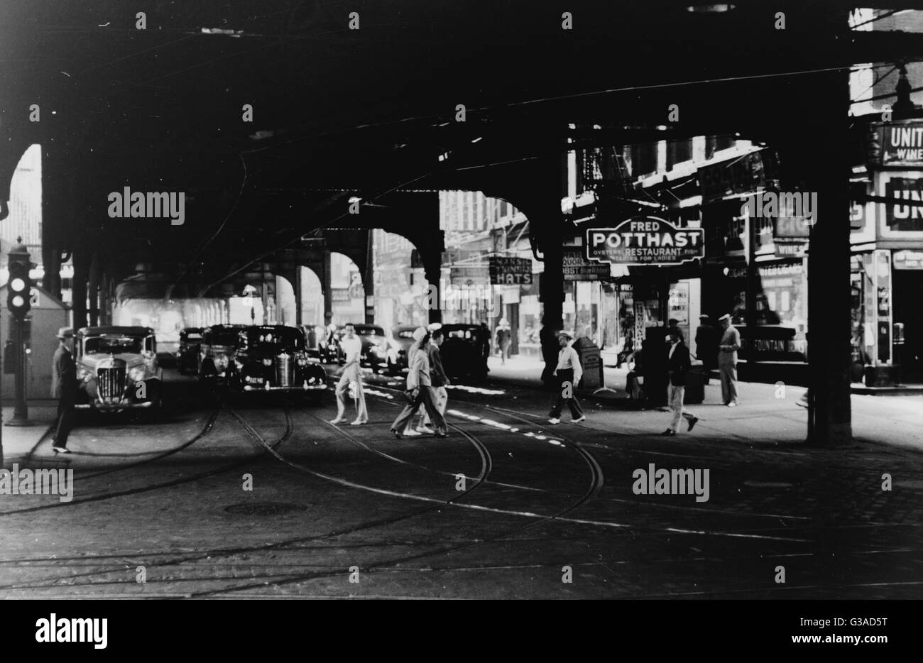 Under the elevated tracks. Chicago, Illinois. Date 1940 July. - Stock Image