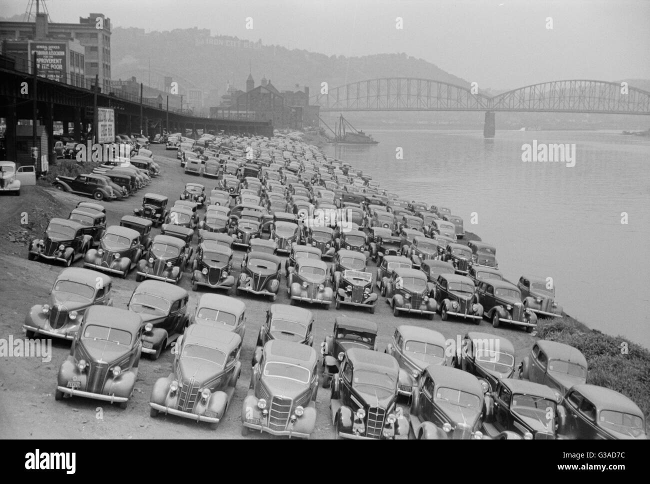 Cars parked along Allegheny River, Pittsburgh, Pennsylvania. Date 1938 July. - Stock Image