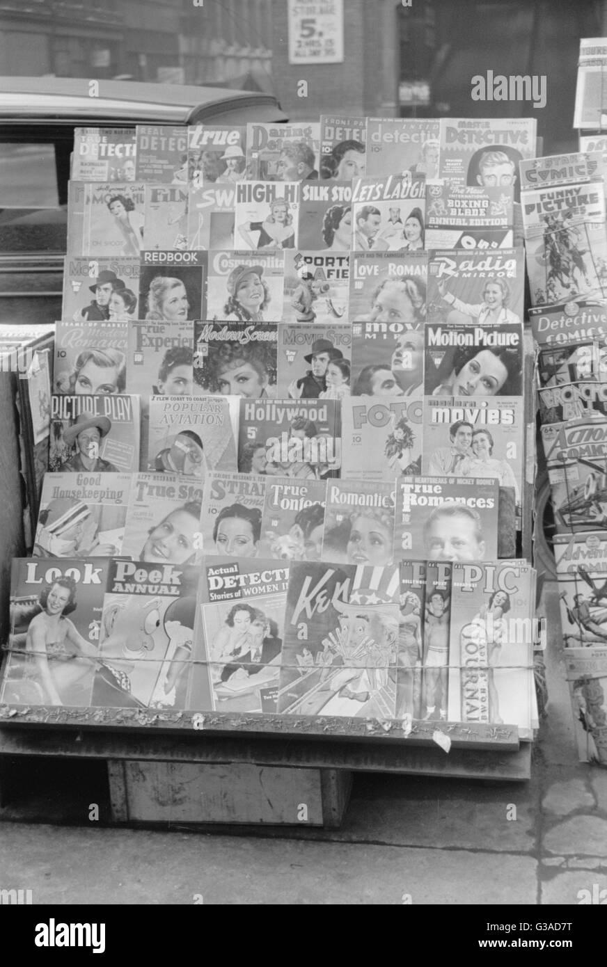 Magazines at newsstand, Saint Louis, Missouri. Date 1939 Jan. - Stock Image