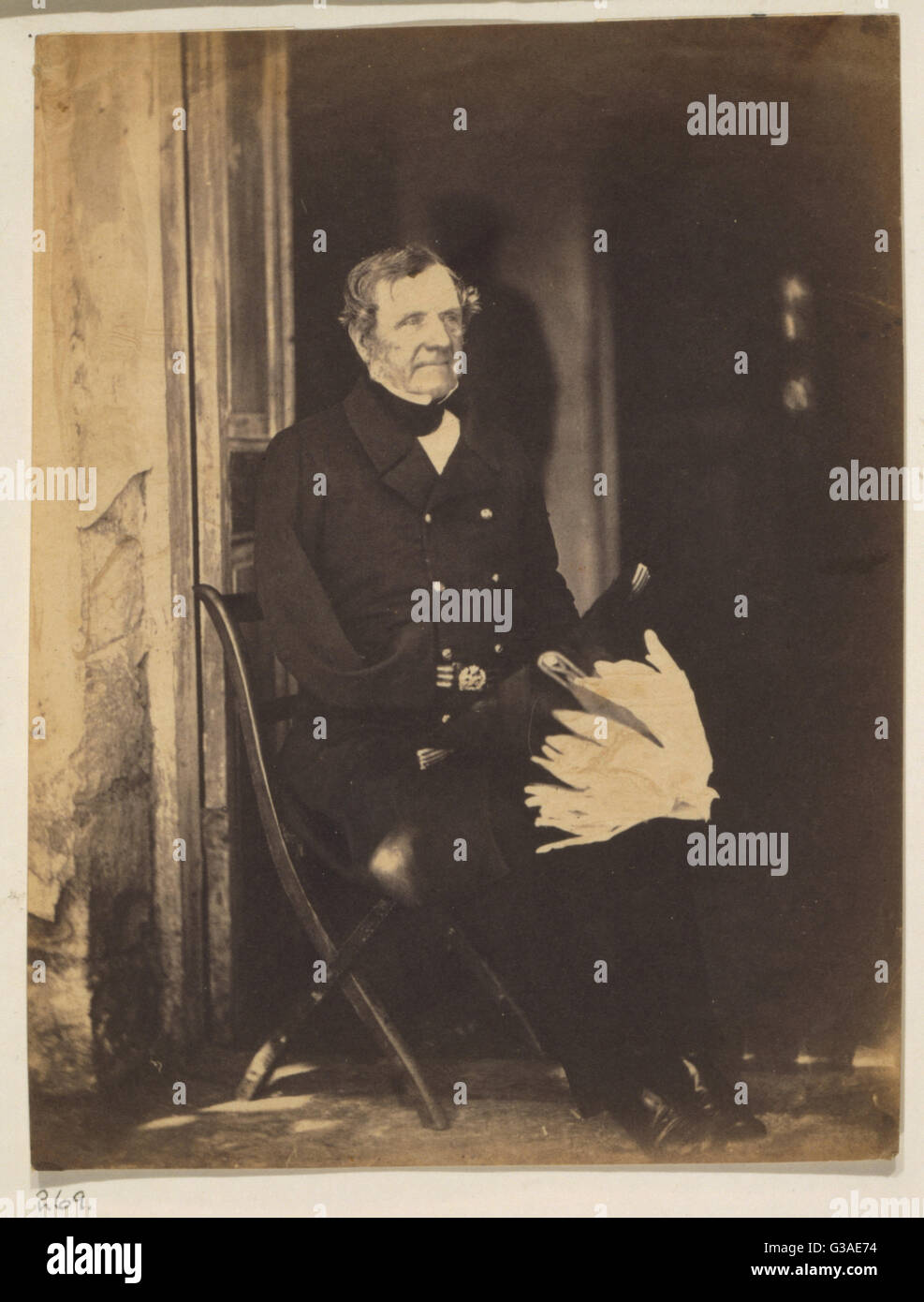 Field Marshall Lord Raglan. Lord Raglan, full-length portrait, seated on chair in doorway, facing slightly right, - Stock Image