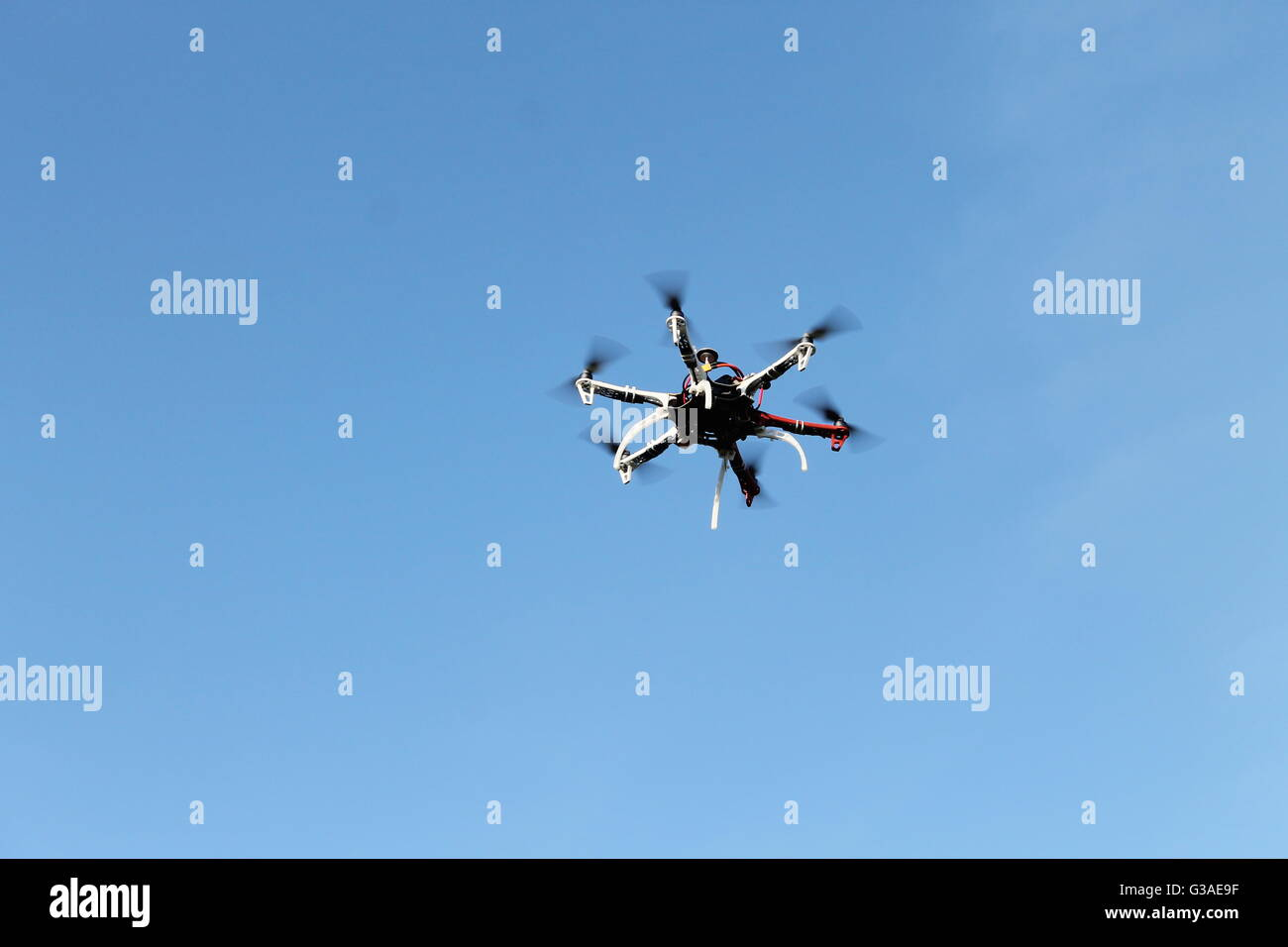 drone, radio controlled, toy, in flight, aerial, drone operator, gadget, boy's toy - Stock Image