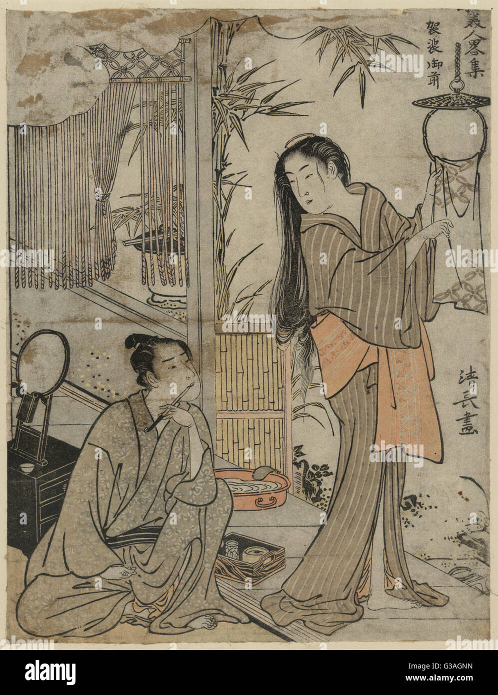 Kesa Gozen of the Heian Period. Print shows a domestic scene with a man sitting on the floor holding writing implements - Stock Image