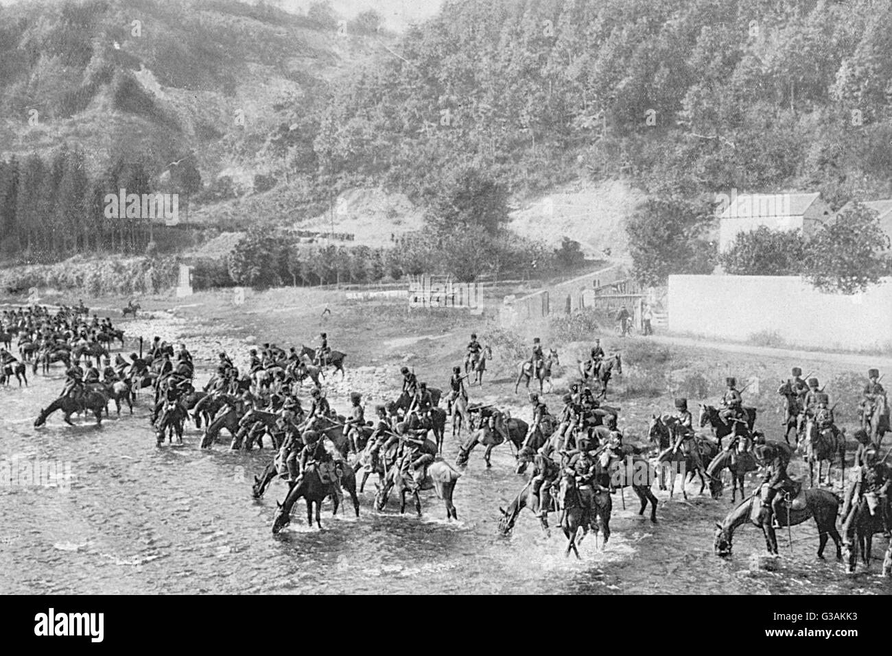A regiment of the Belgian cavalry watering their horses in the early morning.      Date: 1914 - Stock Image