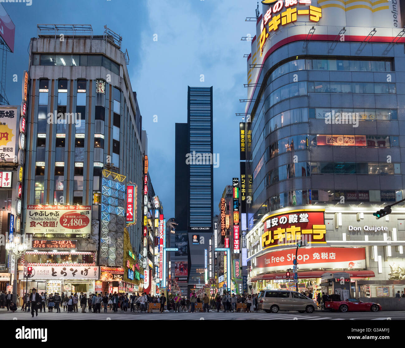 Kabukicho Crossing at night-fall, Shinjuku, Tokyo, Japan Stock Photo