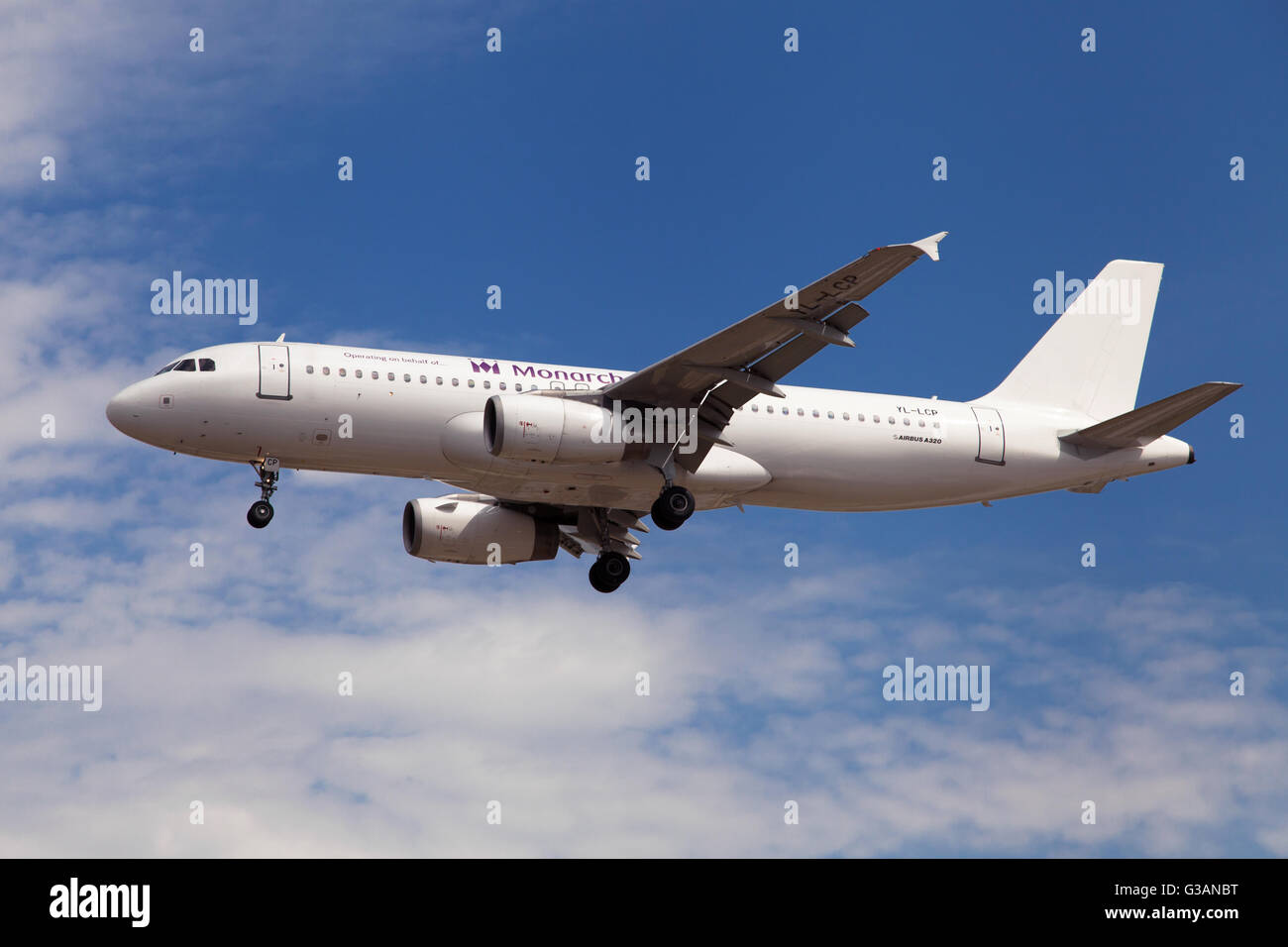 A Monarch Airlines Smartlynx Airbus A320-200 approaching to El Prat Airport in Barcelona, Spain. - Stock Image