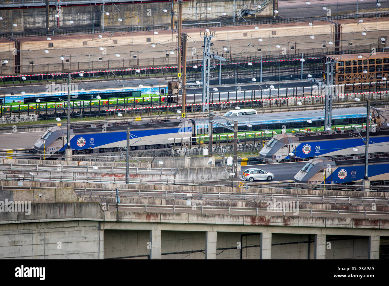 Trains waiting at the Eurotunnel terminal at Folkestone, England. - Stock Image