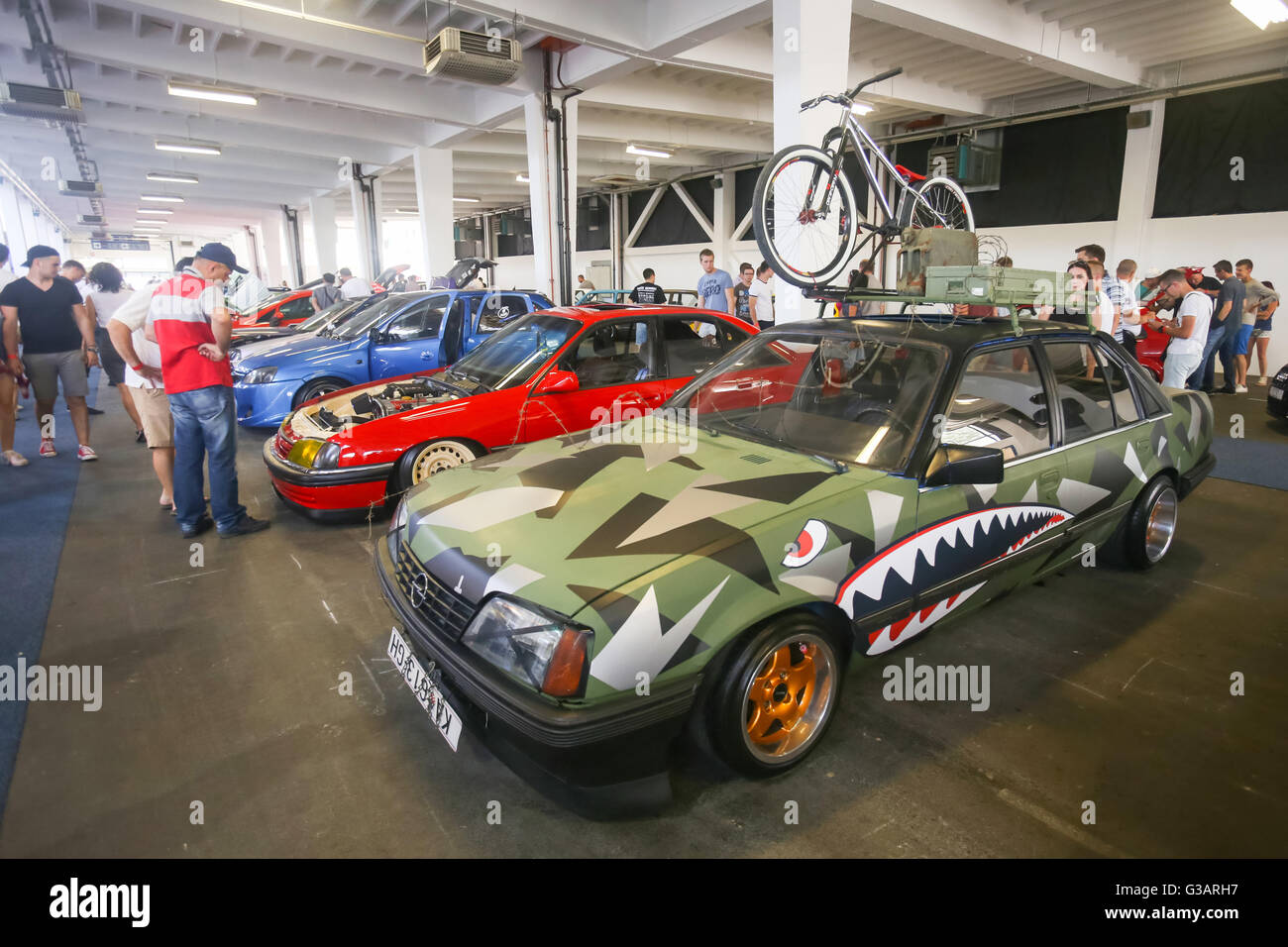 People sightseeing modern redecorated oldtimers cars exhibited at Fast and furious street race in Zagreb, Croatia. - Stock Image