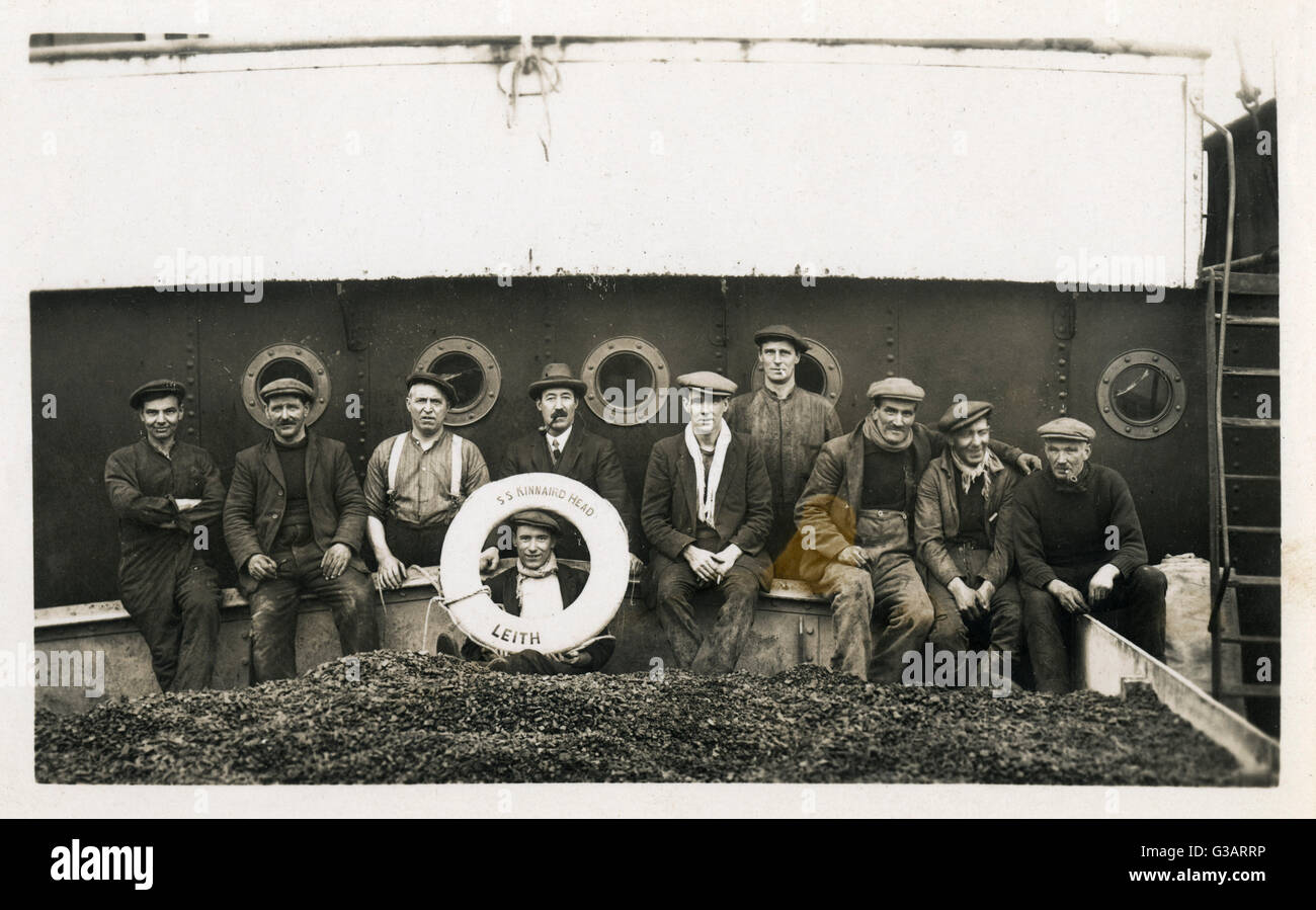 Group photo of men on board the SS Kinnaird Head of Leith. - Stock Image