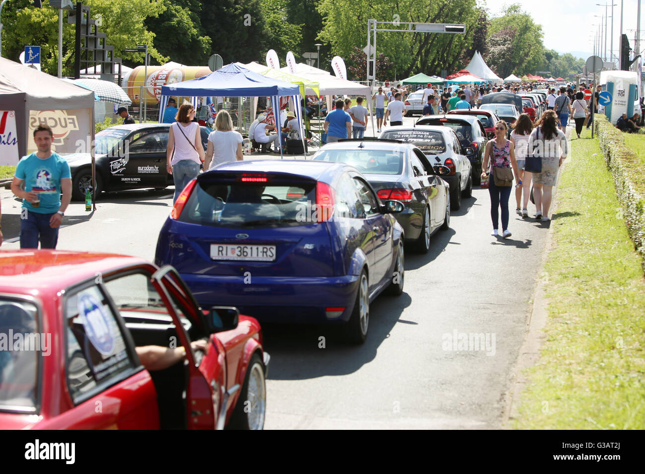 People sightseeing lined up cars waiting for the race at Fast and furious street race at Avenue Dubrovnik in Zagreb, Stock Photo