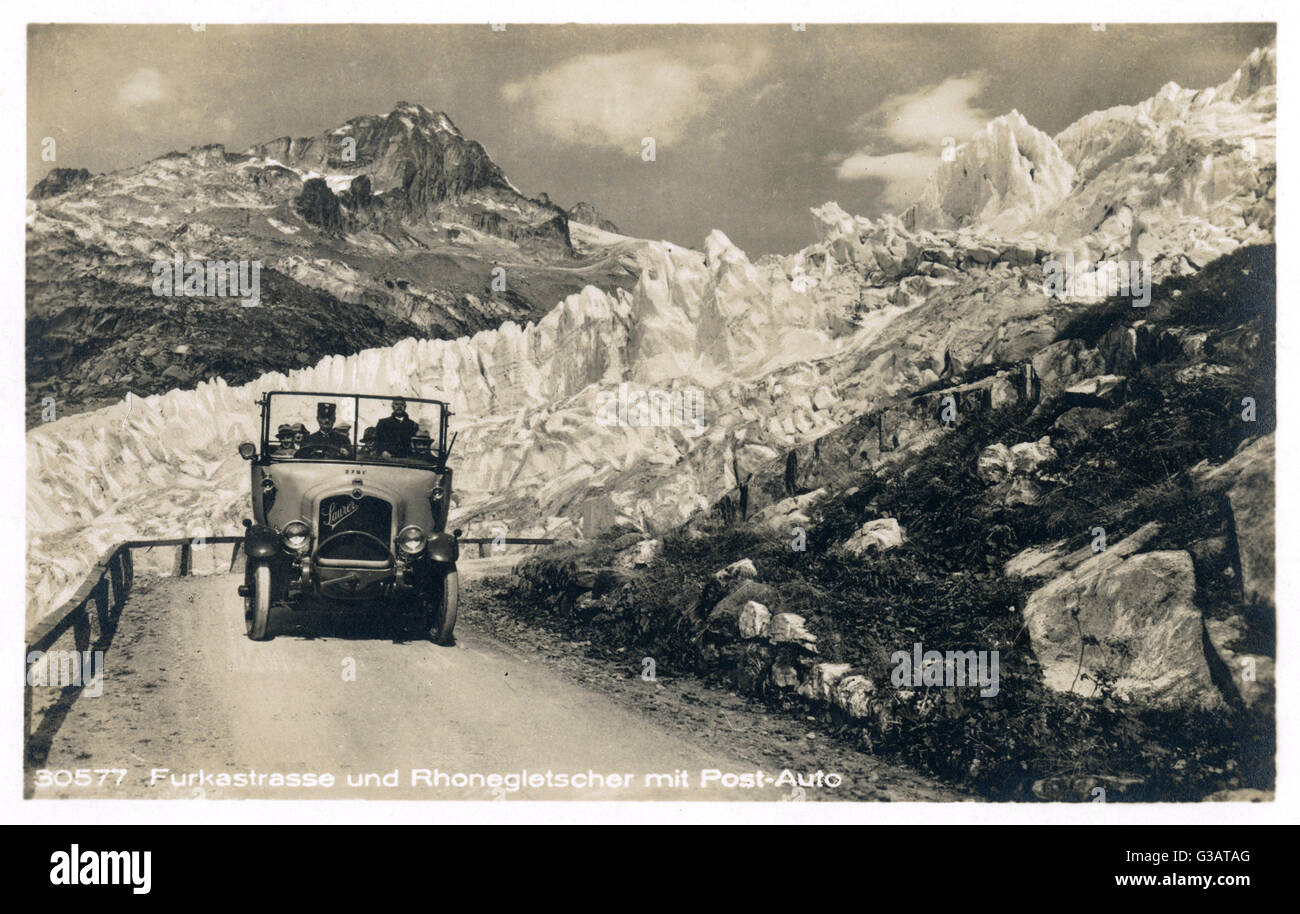 Postal service car with passengers on Furkastrasse, Rhone Glacier, Switzerland.      Date: 1920s - Stock Image