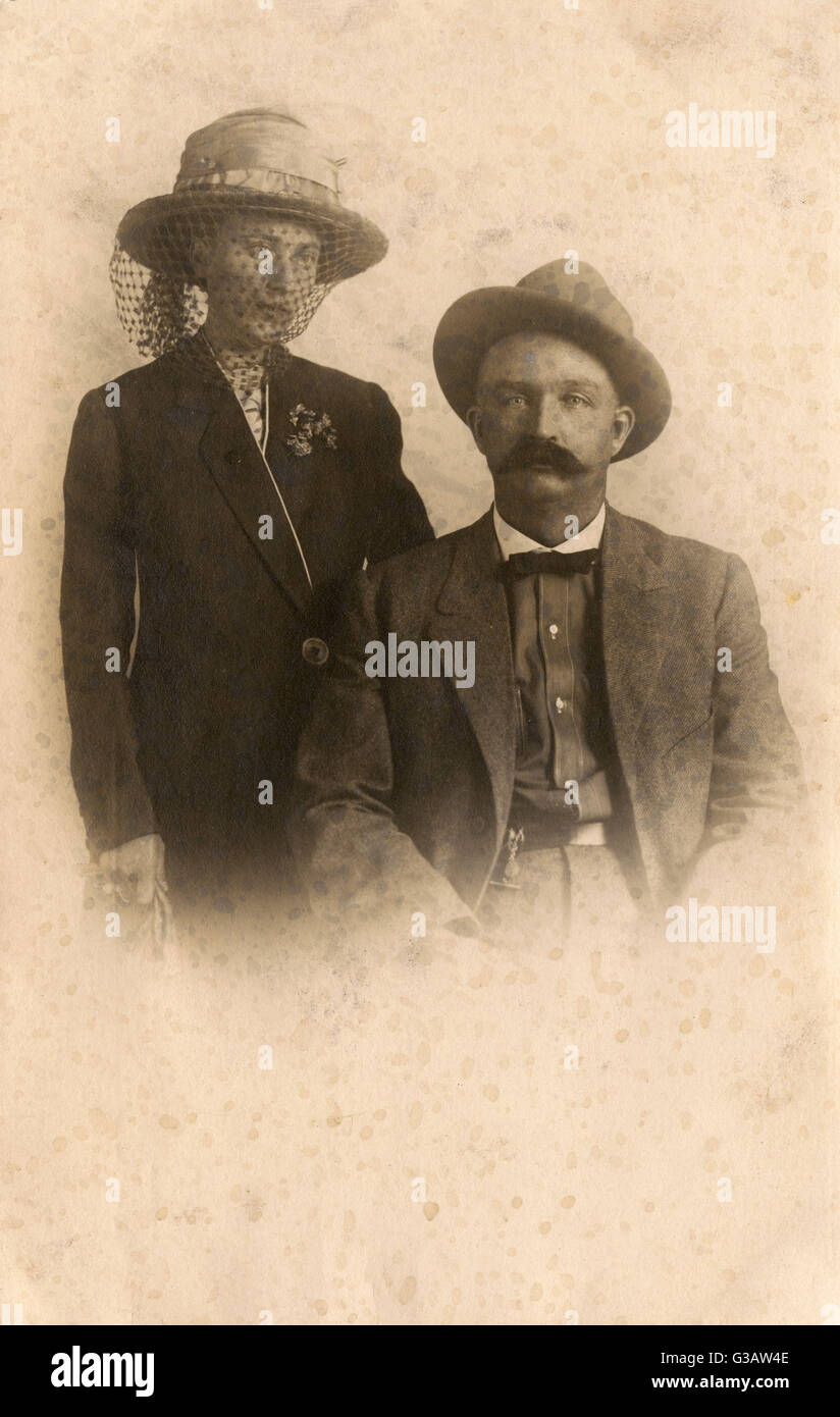 Portrait photograph (on a postcard) of a couple from Sandpoint, the largest city in, and the county seat of, Bonner - Stock Image