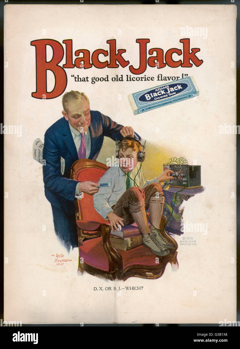 A boy is torn between his  addiction to his radio set and  the bar of Black Jack  liquorice with which his  father - Stock Image