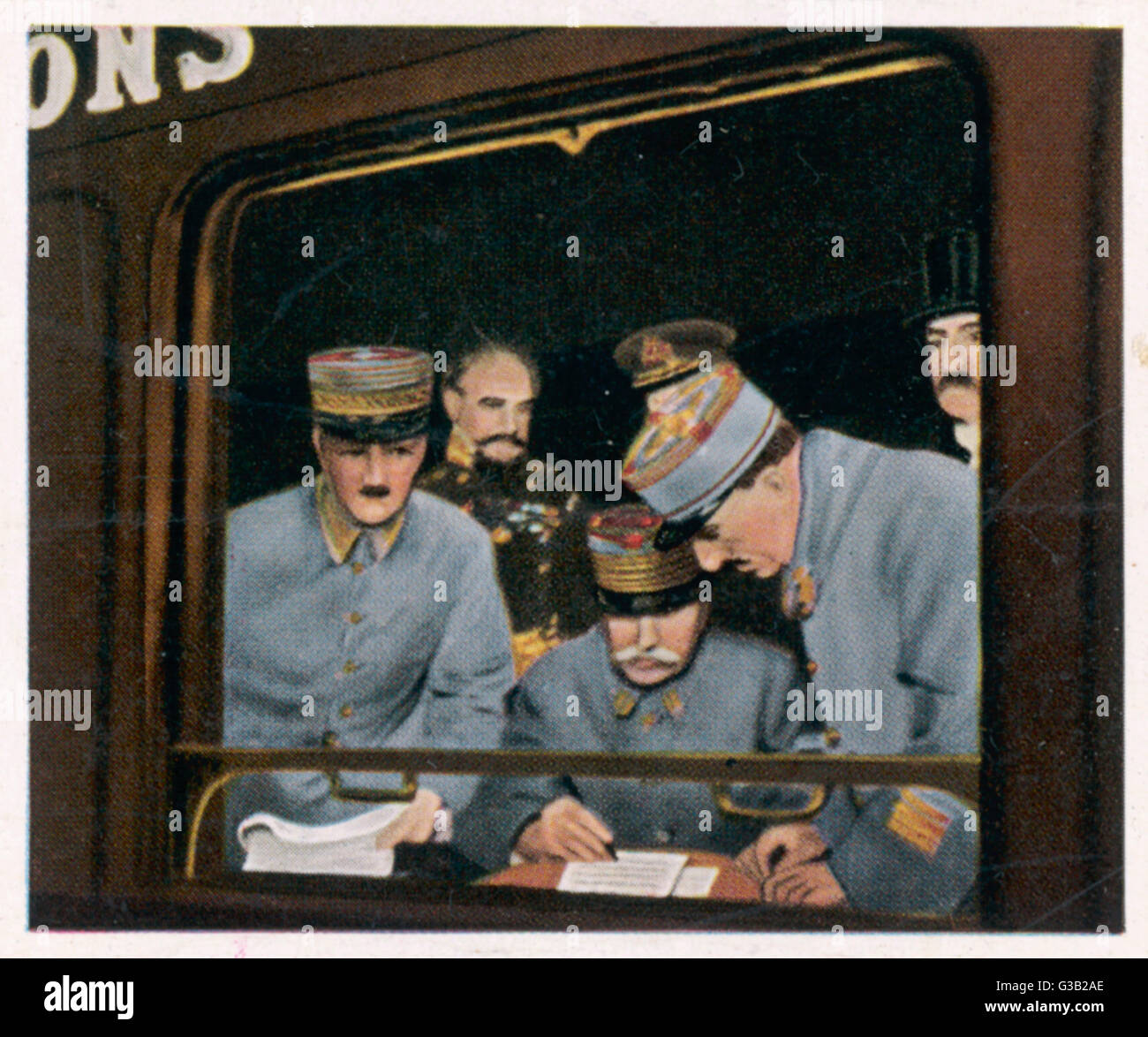 Marshall Foch studies the  terms of the German surrender  in a railway carriage at  Compiegne       Date: 11 November Stock Photo
