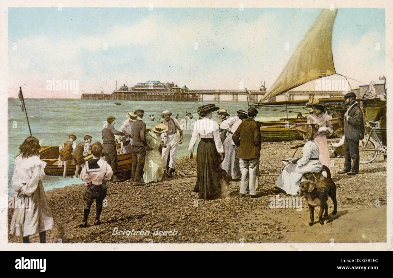Brighton, Sussex:  on the beach        Date: 1913 - Stock Image