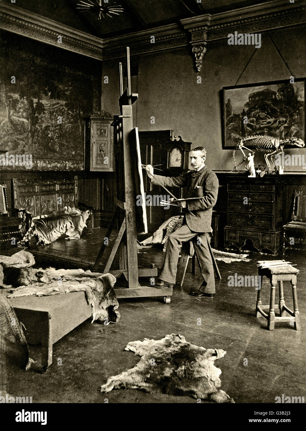 BRITON RIVIERE  Artist, photographed at work  in his studio       Date: 1840 - 1920 Stock Photo