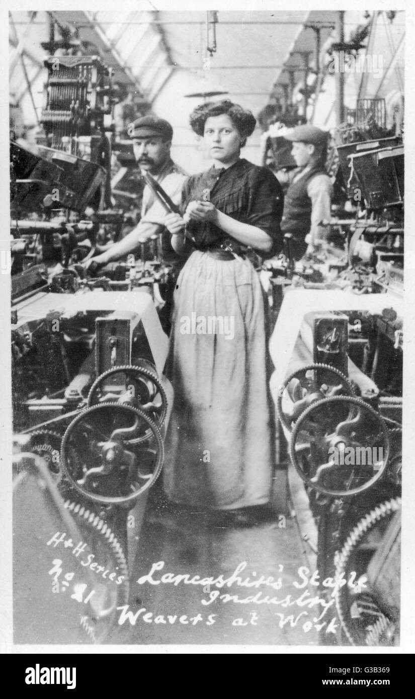 A weaver in a Lancashire  cotton mill.        Date: 1890s - Stock Image