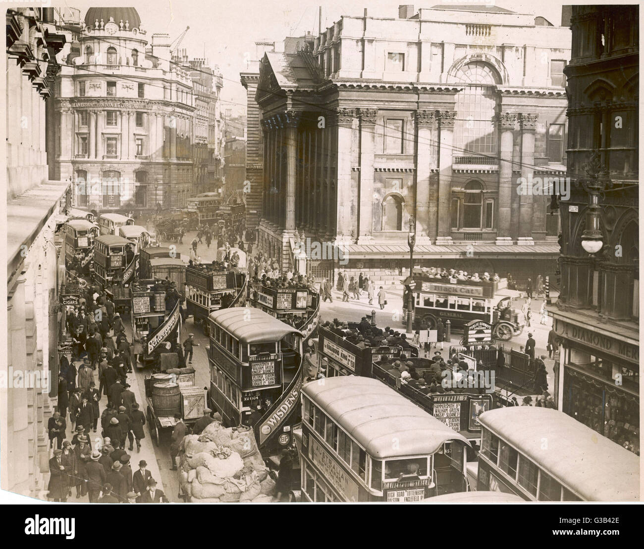 Seventeen buses jam the street  outside the Mansion House,  London - not to mention the  wagons, parked or moving. - Stock Image