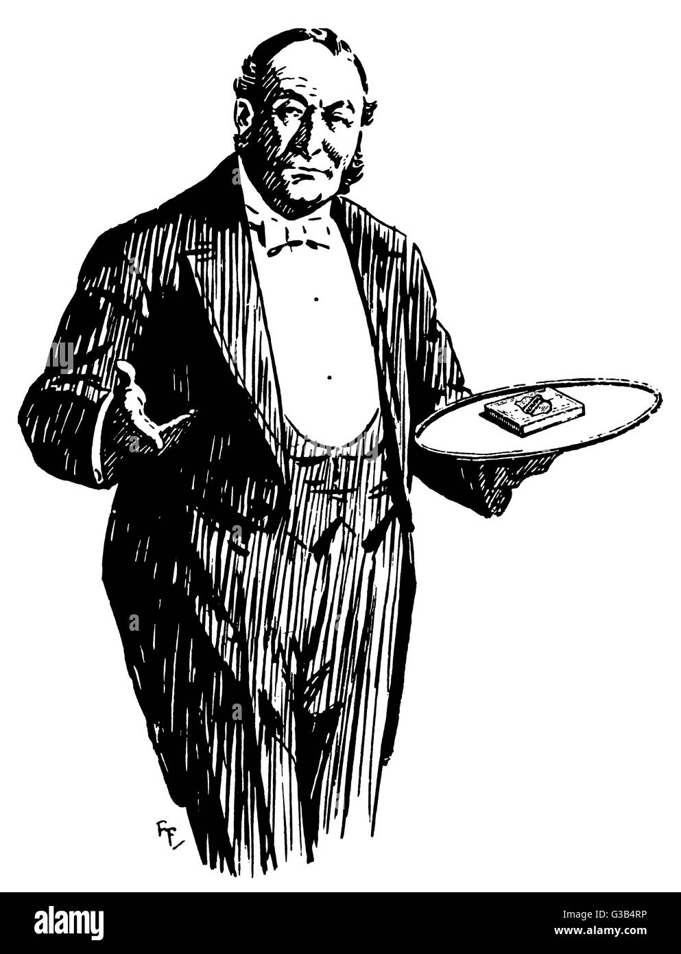 The butler brings a packet  of cigarettes on a tray         Date: circa 1935 - Stock Image