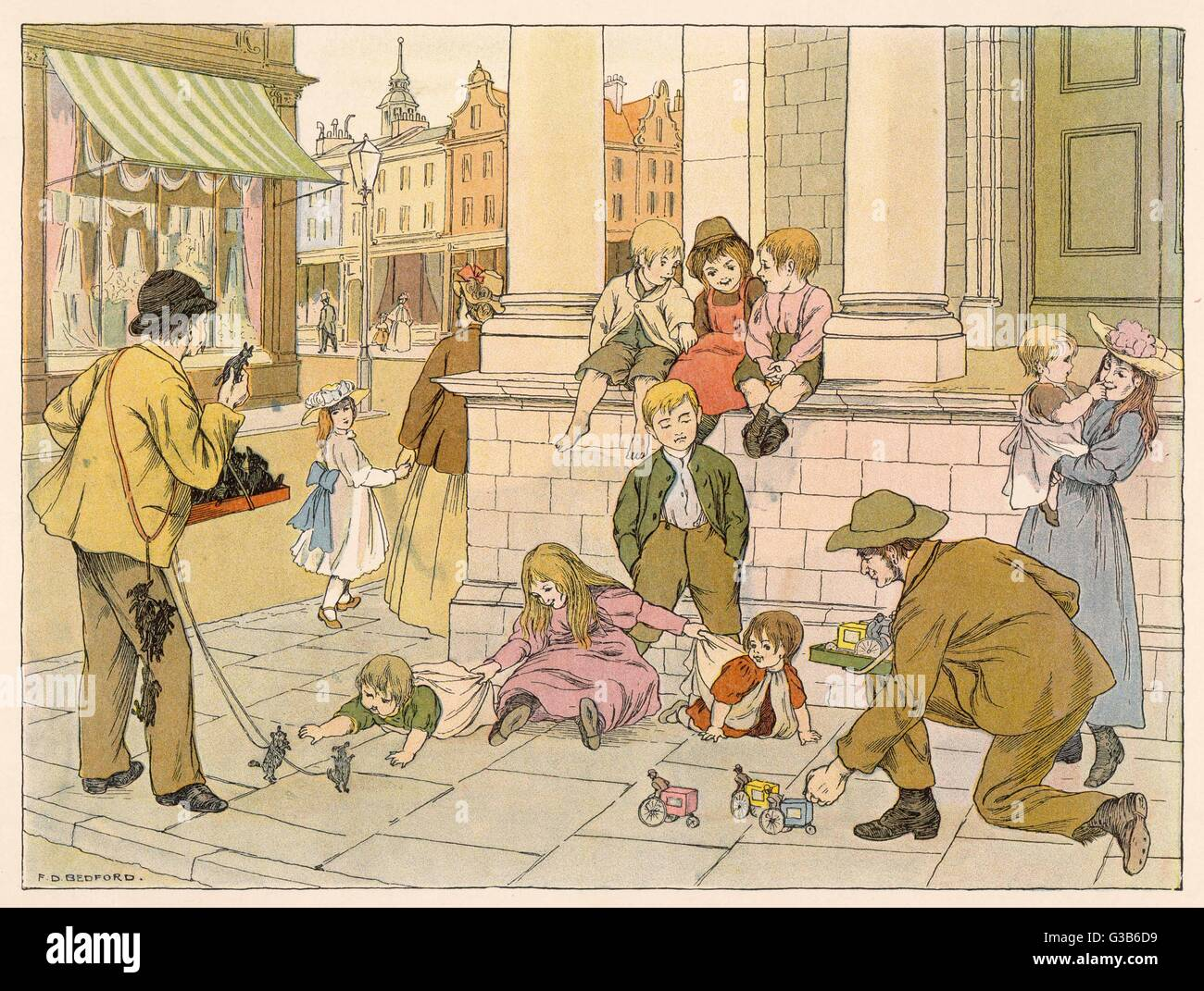 Kerbstone merchants delight  the local children by  demonstrating their toys on  the pavement.       Date: 1899 - Stock Image